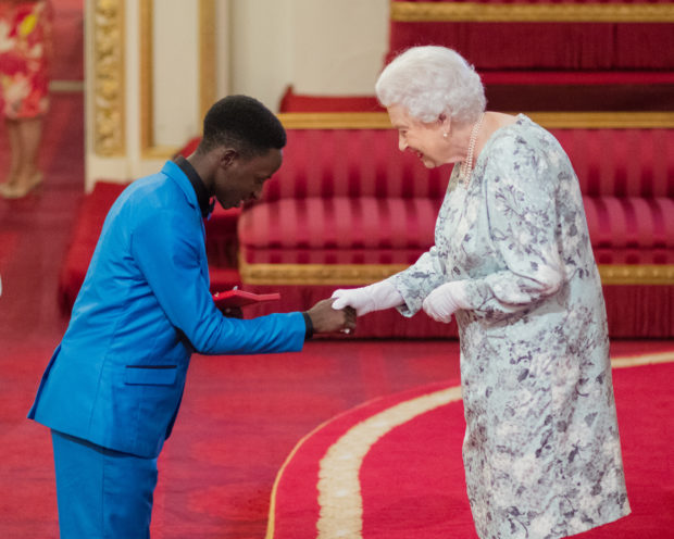 JOEL BARAKA (19) UGANDA The 2017 Queen's Young Leaders receive their award from her majesty the Queen at Buckingham Palace.
